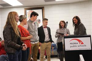 Dr. Wood presents Community Contribution Award to MTHS students, teacher
