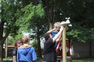 Scouts install a wireless weather station.