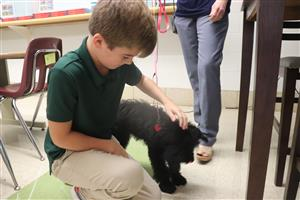 Lindbergh students love to visit with Charley the school dog