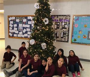 Evergreen tree with fifth grade students