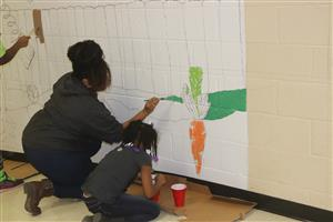 volunteers painting murals at Trewyn School
