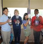 Students made eco-columns from liter soda bottles
