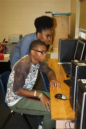 Ms. Mitchell assists student in guidance center