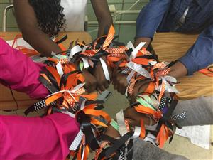 Building School Spirits One Bow at a Time.  Under the direction of Mrs. McKee, students work afterschool making hair bows. If you are interested in purchasing a bow, contact Mrs. McKee