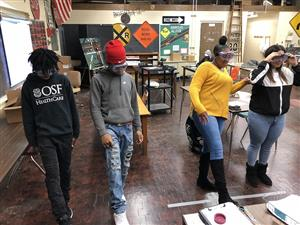Manual drivers education students participate in a mock sobriety test and the effects of impaired and distracted driving with the use of special glasses.