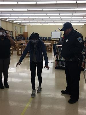 Peoria Police Officer Chris Collins Conducts Mock Sobriety Test with Drivers Ed Students